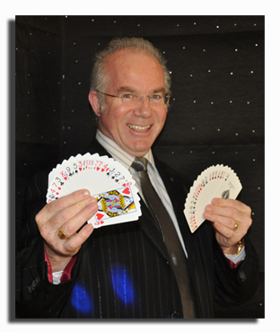 Belfast magician located in Northern Ireland, A belfast magician holding playing cards